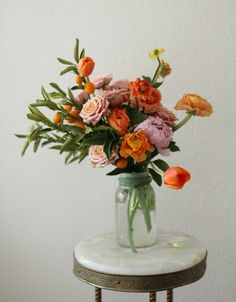 I adore citrus in flower arrangements.