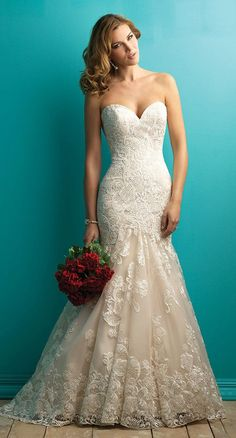 Sexy and embellished, this creamy mermaid gown is both sexy and vibrant.
