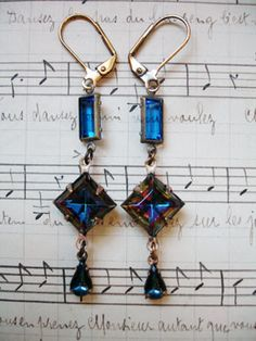 Blue, Bermuda Blue, More Blue, Vintage Repurposed Earrings  From gold-filled leverback earrings hangs a clear blue vintage faceted rectangular connector, a vintage Bermuda blue (blue with flecks of many colors including purple and green and gold!) faceted diamond-shaped connector and from the bottom are vintage smooth glass Montana blue topaz teardrop drops...