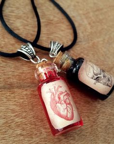 This 2 ml beautiful handmade Head and Heart little vials are filled with red or black liquid and decorated with a label with antique medical drawings.