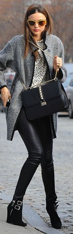 Who made Miranda Kerr's yellow glitter cat sunglasses, black buckle boots, gray coat, and black studded handbag that she wore in New York on November 29, 2012?
