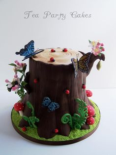 Tree Stump Cake - Love the fiddlehead fern and little extra's. :)