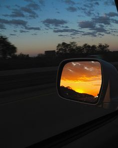 """""""Rear View Sunrise"""" -- Columbia, MO -- Mid-west sunrise captured through the driver's side mirror while traveling westward on I-70."""