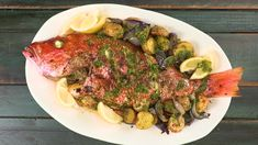 Whole Roasted Red Snapper with Potatoes and Onions Recipe | MyRecipes Whole Red Snapper Recipes, Whole Fish Recipes, Baked Whole Fish, Baked Snapper, Big Green Egg Bbq, One Dish Dinners, Onion Recipes, Seafood Recipes, Seafood Dishes