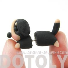 - Details - Sizing - Shipping A puppy dog shaped stud earring in black and tan! This dog shaped earring is super cute and handmade from polymer clay! Please allow for slight differences from the one p