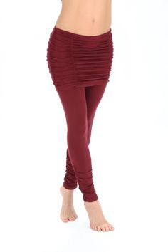 Our new basic leggings paired with ruched skirt overlay.  - Ruched detail contours and sculpts the booty and offers modest yet sexy appeal. - Wear to yoga, dance or out on the town with your favorite boho top and slouchy boots. - Looks great with the Hooded Athena - Embellished with new chic and classy Melodia branded hardware