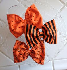 Hey, I found this really awesome Etsy listing at http://www.etsy.com/listing/154961383/set-of-3-fabric-halloween-bows