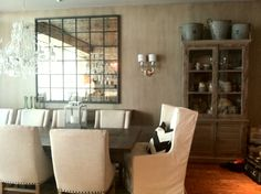 Aged wood, linen chairs, glass panel mirror, dining room, neutral interiors