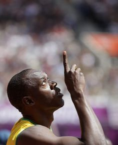 Men's 100 Meter Dash Jamaica's Usain Bolt gestures before competing in a men's heat during the athletics in the Olympic Stadium at the 2012 Summer Olympics, London, on Aug. Long Jump, High Jump, Sky Gif, Track Team, 2012 Summer Olympics, Pole Vault, Usain Bolt, Training Motivation, Olympic Games