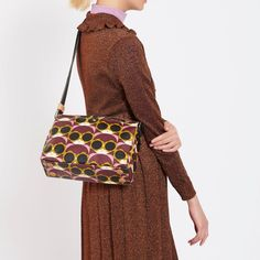 Browse our collection of designer accessories by Orla Kiely online now at the Kilkenny Shop. Orla Kiely Handbags, Cute Pixie Cuts, Shades Of Purple, Designer Handbags, Flower Power, Sunnies, 1960s, Champagne, Cherry