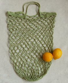 Crocheted Linen Grocery Tote by Purl Soho - Single crochet and chain stitch, with a strong band around the top - Without the large solid bottom of the Market Bag, it scrunches up even smaller in your purse or pocket.