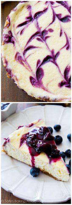 Ultra creamy homemade cheesecake swirled with a sweet blueberry swirl. All on top of my favorite buttery graham cracker crust! sallysbakingaddiction.com