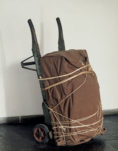Christo Package on Hand Truck, 1973 Metal, tarpaulin, wood, and rope, 51 15/16 × 24 1/4 × 29 in. (131.9 × 61.6 × 73.7 cm).