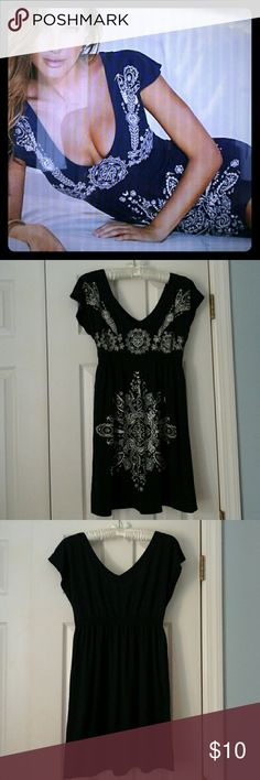 Venus Beach Dress / Cover Up Deep  low neck print dress . Navy blue. Bought to wear at the beach.  Excellent condition.  Polyester,  rayon, spandex VENUS Dresses Mini