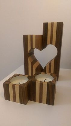 Candle holder family. Candle holder made of Iroko, Canadian maple and Sapeli. Hand made. #WoodworkingProjectsCandleHolder