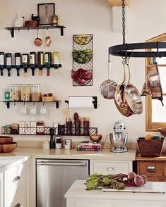 "Small Kitchen: decorative wire metal baskets for wall storage/shelves (here for spice rack, cooking utensils & fruit) + wine ""rack"" that is really a wine shelf! <3 the use of wall space & the black on white."