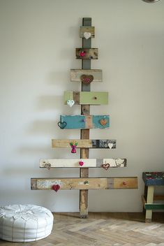 scrap wood / barn wood Christmas tree.  Hang ornaments on rusty nails for any holiday