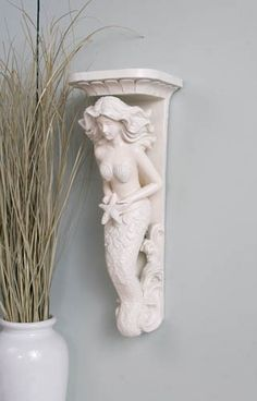 mermaid wall sconce beach ocean decor.....for either side of the shell mirror in the dining room..