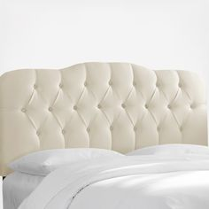 This headboard is embellished with handcrafted diamond tufts, upholstered in chic, silk-like shantung. Its contemporary silhouette is sure to add style to any bedroom. Handmade in the USA, adjustable legs increase in height.  Attaches to any standard bed frame.  Easy assembly required. Mattress and box spring required.