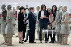 First Lady Michelle Obama (3rd Right) with her daughters Malia Obama (Right) and Sasha Obama (2nd Right) visit the Museum of Terracotta Warriors During a visit to the historic excavation website on March 24, 2014 in Xi'an, China.  Michelle Obama's one-week-long visit in China Will Be Focused on educational and cultural exchanges.