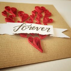 Hand quilled Valentine's Day ...... Using quilling papers worked into a heart shape on a recycled kraft card, add a handwritten sentiment to create a simply beautiful Valentines Day, Wedding or Anniversary card. All products available from Arty Crafty by mail order.