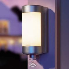 Outdoor wall light with motion sensor by STEINEL