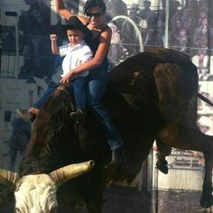 Cowboy Mateo and Mom riding the Bull at the Rodeo