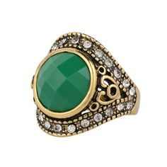 Emerald and gold bohemian engagement ring