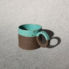 The hand-made coffee cups are individually shaped and painted by doppiocotto. With the plate method, which is one of the ceramic forming methods, the body base and the handle are combined together and the side walls and the base in the plate are combined and the form you see is reached. After drying for 3 days, the debris-free form enters the oven for the first firing and after 24 hours in the oven, it is baked again for a further 24 hours and this is the last time you have seen it. Coffee Lover Gifts, Gift For Lover, Coffeecup, Side Wall, Stoneware, Coffee Mugs, Oven, Cups, Walls