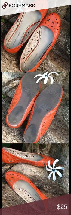 Adrienne Vittadini Orange Flats Super cute flats with flower cutouts. The color is a deep muted orange and looks amazing with many other colors! Some scuff on heal area, gently used but in good condition. Adrienne Vittadini Shoes Flats & Loafers