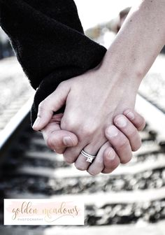 engagement photo, holding hands, train tracks, ring