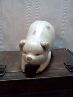 Vintage Cast Iron Pig Decoration Door Stop. $24.99, via Etsy.