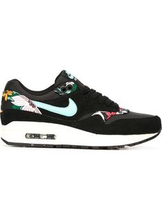 These are nice.  I like it when there's a pop of colour to break up the black.  Shop Nike 'Air Max 1' sneakers in  from the world's best independent boutiques at farfetch.com. Shop 300 boutiques at one address.