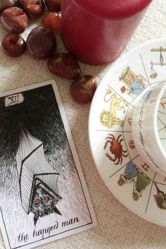 Future Tarot Meanings: The Hanged Man — Lisa Boswell Hanged Man Tarot, The Hanged Man, Card Deck, Deck Of Cards, Tarot Major Arcana, Tarot Card Meanings, Red Candles, Fortune Telling, Psychic Readings