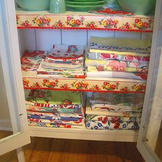 PieSafe with pretty shelf trim filled with vintage Jadite and linens