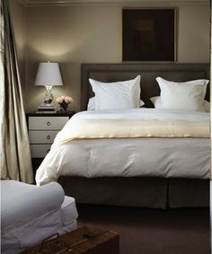 luxurious gray bedroom design with charcoal gray headboard with nailhead trim, charcoal bed skirt, crisp white bedding with soft pink throw, two tone nightstands Grey Bedroom Design, Gray Bedroom, Home Bedroom, Bedroom Decor, Charcoal Bedroom, Master Bedrooms, Bedroom Designs, Bedroom Ideas, Grey Headboard