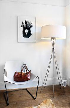 stark white decor against a stark white wall for monochromatic drama