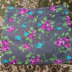 """Beautiful Denim Skirt Beautiful denim skirt with vibrant colored flowers. Measures 13"""" in length 97% Cotton  / 3%Spandex I Love H81 Skirts Mini"""