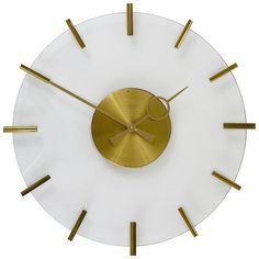 Junghans Ato-Mat Lucite Brass Midcentury Sun Wall Clock, Germany, 1950s   From a unique collection of antique and modern clocks at https://www.1stdibs.com/furniture/decorative-objects/clocks/