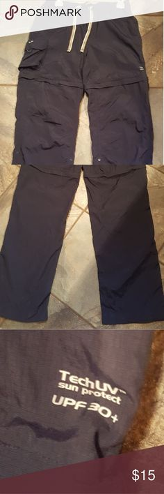 Hiking pants Light weight Dark blue hiking pants. Draw string elastic waist. Unzips at knees to make shorts and can also roll up pants. Side snaps. Good shape and great for hiking. Material drugs quick when wet. Gander Mountain Pants Track Pants & Joggers