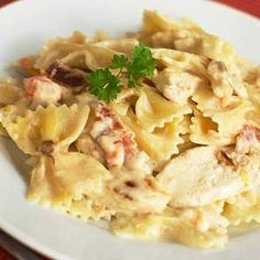Sweet tomatoes and smoky bacon combine to make a deliciously rustic flavor in this creamy chicken pasta dish popular at Johnny Carinos. No need to go out to the restaurant when you can make this copycat favorite at home!/