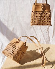 These woven tie cross-body bucket bags are gorgeous!