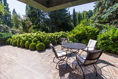 Terrace with a great view of the richly planted garden. Old Trees, Classic Interior, Terrace Garden, Terraces, Great View, Luxury Real Estate, Vienna, Beautiful Gardens, Oasis