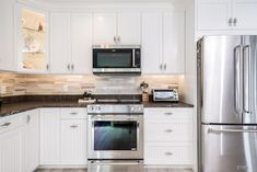 Gorgeous white, bead-board cabinets for this kitchen that was part of a whole home remodel on Island Estates.