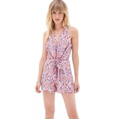 8debb7a770ad Forever 21 Ivory Purple Romper Jumpsuit. Free shipping and guaranteed  authenticity on Forever. Tradesy