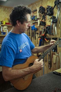 Jay in the luthier's shop working on a vintage uke