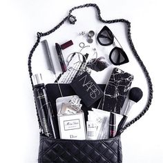 What's in my bag flat lay fashion Black and white