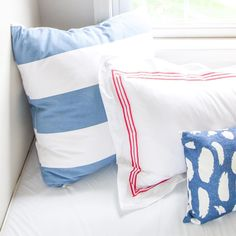 Current favorite #color scheme: dusty pale blue with bright poppy red. And a dash of navy too. Pillows left to right: @serenaandlily @annieselke @minted http://ift.tt/1JhoRaY