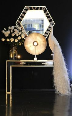 Art Deco vignette with a stuffed albino peacock! Man, this would look so fabulous in my house. So high class. Love it!!