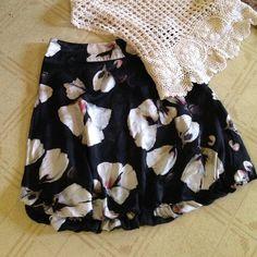 White House Black market skirt White House Black market skirt     lovely white bloom pattern shell 100% silk lining 100% polyester White House Black Market Skirts Midi